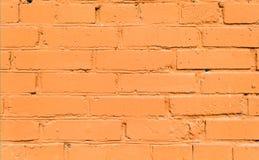 Fond orange de mur de briques Photographie stock
