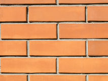 Fond orange de mur de briques Image stock