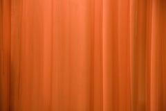 Fond orange de rideau image stock