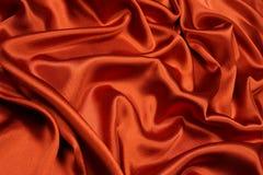 Fond orange de satin Photos libres de droits