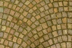 Fond orange de trottoir de rue, texture de roche Photographie stock libre de droits