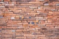 Fond orange grunge de texture de mur de briques, mur extérieur photos stock