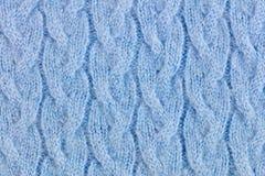 Fond ornementé tricoté de laine bleu-clair de tissu Photos stock
