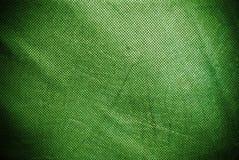 Fond ou texture vert troué et plissé de toile photos stock