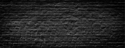 Fond panoramique de mur de briques noir photographie stock