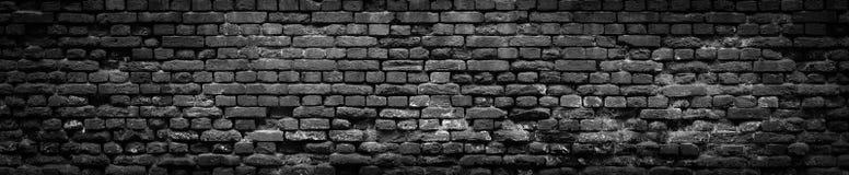 Fond panoramique de vieux mur de briques noir dans la haute résolution image libre de droits