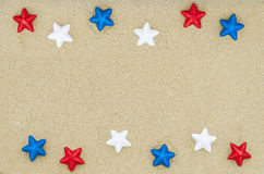 Fond patriotique des Etats-Unis sur la plage sablonneuse Image stock