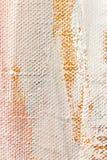 Fond peint à la main abstrait de toile dans des couleurs oranges Photo stock