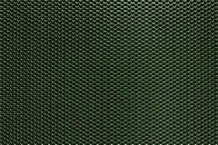Fond perforé vert en métal Photographie stock libre de droits