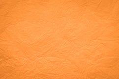 Fond plissé par orange de papier de soie de soie Photos stock