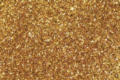 Fond rempli de scintillement brillant d'or Photographie stock libre de droits
