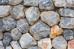 Fond rocheux de mur Photographie stock