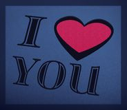 Fond romantique avec je t'aime le texte Images stock
