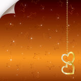 Fond romantique lumineux avec deux coeurs d'or Photo libre de droits