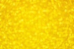 Fond rond d'or de bokeh avec les lumières lumineuses de scintillement d'or pour le jour de Valentine Day ou de femmes Texture jau images libres de droits