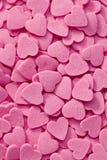 Fond rose de coeurs Photos stock