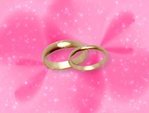 Fond rose de lueur avec des boucles de mariage Photographie stock libre de droits