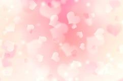 Fond rose mou de bokeh de coeurs de tache floue Images libres de droits