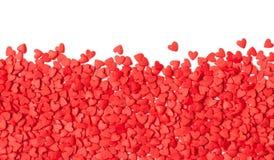 Fond rouge avec de petits coeurs rouges Copiez le texte de l'espace Photos stock