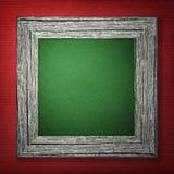 Fond rouge avec le cadre en bois Photo stock