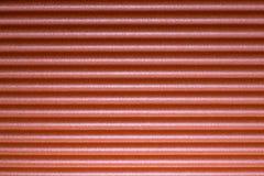 Fond rouge avec le modèle de rayure Photographie stock