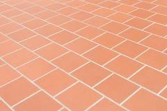 Fond rouge carrelé en céramique de texture de mur de briques de plancher photographie stock