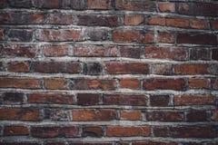 Fond rouge carrelé et industriel géant de mur de briques image libre de droits