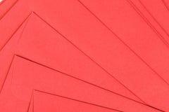 Fond rouge d'enveloppe Photo stock
