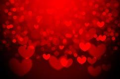 Fond rouge de bokeh de Noël de coeur photos stock
