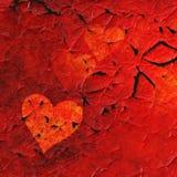 Fond rouge de coeurs avec l'effet de peinture d'épluchage Photographie stock libre de droits