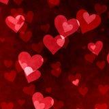 Fond rouge de coeurs de Saint-Valentin. Texture de grunge d'amour Photo stock