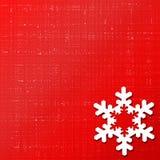 Fond rouge de flocon de neige Photographie stock