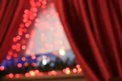 Fond rouge de lumières de Noël Photographie stock