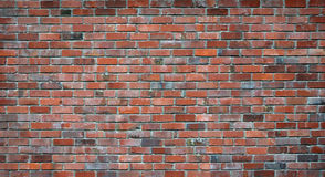 Fond rouge de mur de briques Photographie stock libre de droits