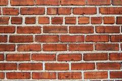 Fond rouge de mur de briques Photographie stock