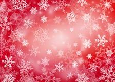 Fond rouge de Noël avec des flocons de neige Images stock