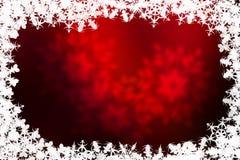 Fond rouge de Noël avec des flocons de neige Photographie stock libre de droits