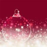 Fond rouge de Noël avec la babiole Photographie stock