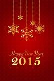 Fond 2015 rouge de nouvelle année avec les flocons de neige d'or Images stock