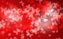 Fond rouge de Saint-Valentin de bokeh de papillon de ton Image libre de droits