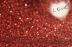 Fond rouge de scintillement avec amour Photographie stock