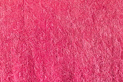 Fond rouge de serviette de bain Photographie stock