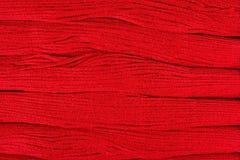 Fond rouge de soie de broderie Photographie stock