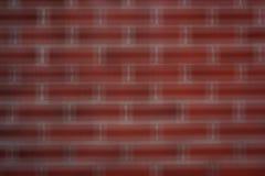 Fond rouge de tache floue de mur de briques Image libre de droits