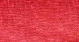 Fond rouge de textile de tissu de knit Image stock