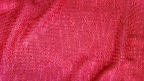 Fond rouge de textile de tissu de knit Images stock