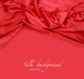 Fond rouge de tissu en soie Photographie stock