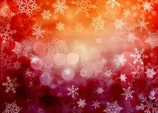 Fond rouge divers de Noël avec des flocons de neige Photographie stock libre de droits