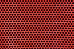 Fond rouge en métal avec les trous ronds images stock