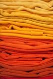 Fond rouge et jaune de vêtements Photos libres de droits